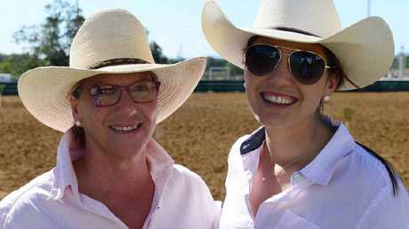SPECTATOR SPORT: Robyn and Polly Hanigan, from Coonamble in NSW, at the Paradise Lagoons campdraft, watching Polly's dad Terry compete.