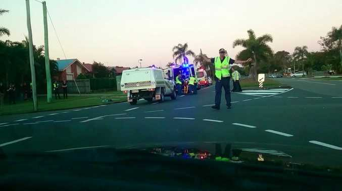 Police direct traffic away from the scene where a motorbike and car collided at the intersection of Bridge Rd and Goldsmith St tonight.