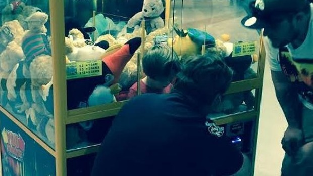 The toddler stuck in the toy machine at a Cairns shopping centre. Photo: Supplied/Brisbane Times