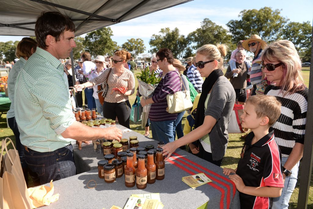 Image for sale: FIG DESSERT: Sara Rogers, Matt Rogers and Sue Wilkens talk to Will Randall from Lava Valley Produce at The Flats Farmers Market. Photo: Mike Knott / NewsMail