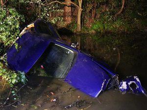 Driver flees after car crashes into pond - Coffs Harbour
