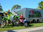 Jayden and Mia Stronach with their motocross bikes, which include Jayden's KX 85 and KX 250F and Mia's peewee 50.