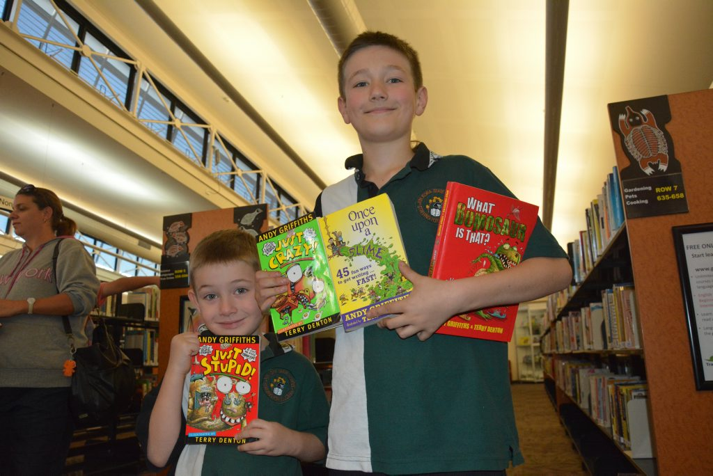 Elliot Smith, 5, and Robbie Smith, 10. Robbie said one of his favourite books was Once Upon a Slime - how to start writing. At author Andy Griffith's book signing at Gladstone City Library on Tuesday.