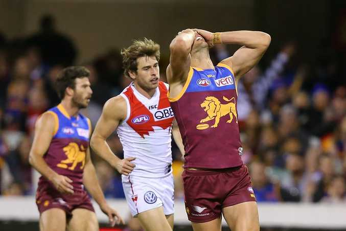 BRISBANE, AUSTRALIA - JULY 12: Brent Staker of the Lions reacts after missing a goal during the round 15 AFL match between the Brisbane Lions and the Sydney Swans at The Gabba on July 12, 2015 in Brisbane, Australia. (Photo by Chris Hyde/Getty Images)