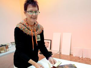 Rockhampton printmaker Peta Lloyd prepares her Crocodile Series exhibition at the Rockhampton Art Gallery.