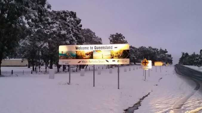 The iconic snow-covered welcome to Queensland sign.