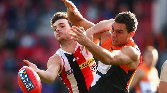 SYDNEY, AUSTRALIA - JULY 12: Dylan Robertson of the Saints and Tom Downie of the Giants contest the ball during the round 15 AFL match between the Greater Western Sydney Giants and the St Kilda Saints at Spotless Stadium on July 12, 2015 in Sydney, Australia. (Photo by Cameron Spencer/Getty Images)