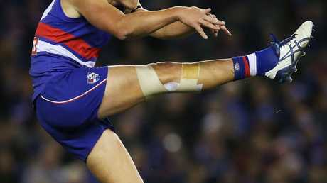 MELBOURNE, AUSTRALIA - JULY 04: Jack Redpath of the Bulldogs kicks the ball during the round 14 AFL match between the Western Bulldogs and the Carlton Blues at Etihad Stadium on July 4, 2015 in Melbourne, Australia. (Photo by Michael Dodge/Getty Images)
