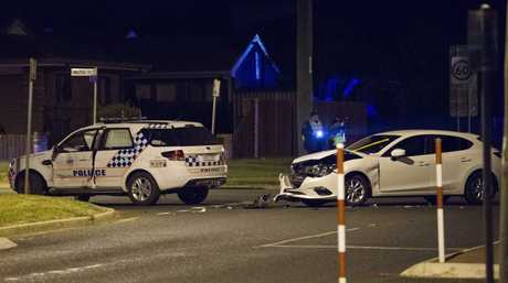 Police investigate after a crash involving a marked police vehicle.
