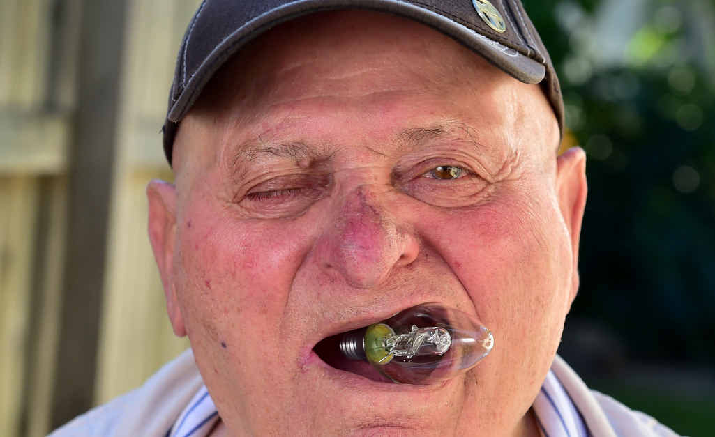 GOOD EATING: Former international strongman Leon Samson tries a meal for which he became famous during his younger years.
