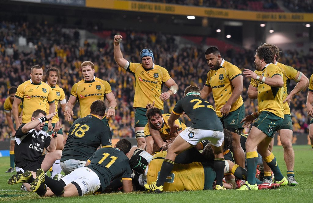 Wallabies player Tevita Kuridrani (centre) reacts after scoring a try after the full time siren and give Australia a win in the Rugby Championship test match against the South African Springboks at Suncorp Stadium in Brisbane Saturday, July 18, 2015. (AAP Image/Dave Hunt) NO ARCHIVING, EDITORIAL USE ONLY