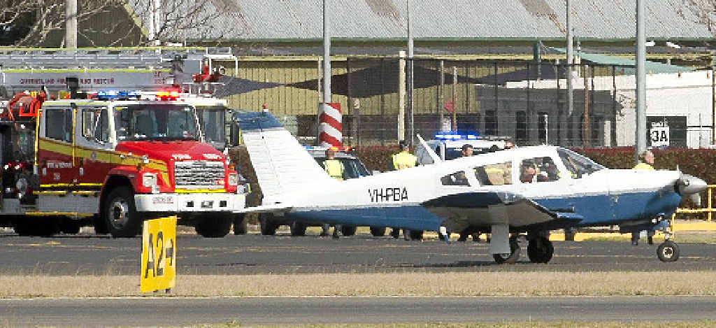 SAFE LANDING: A plane successfully landed at Toowoomba Airport despite an initial problem with the landing gear yesterday.