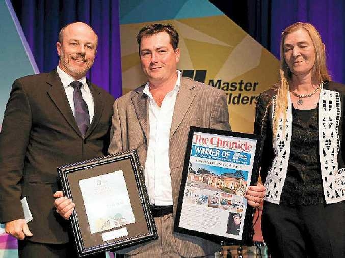 TOP WIN: House of the year winner Nick Ruhle (centre) collects his award from Lex Greenhalgh and The Chronicle's Marg Alexander at the Master Builders Housing and Construction awards.