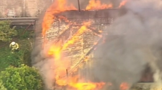Firefighters working to control a blaze at Ashgrove in Brisbane's north-west. Photo: Channel 7