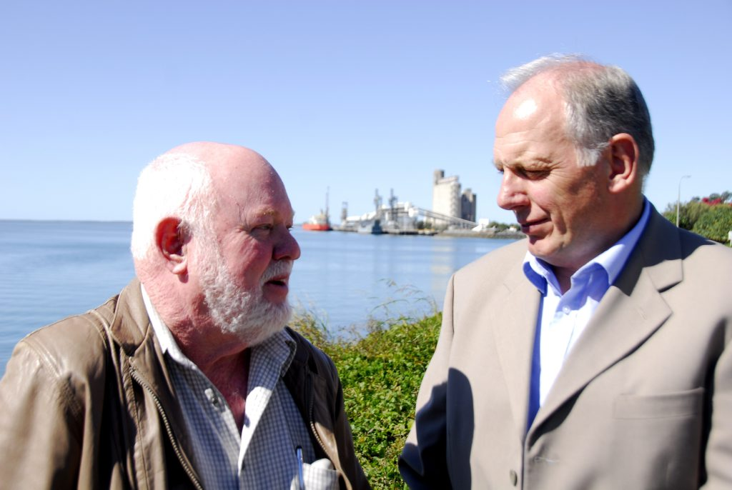 Former Gladstone harbourmaster Mike Lutze (left) and International Seafarers' Welfare Assistance Network (ISWAN) project manager and UK Merchant Navy Welfare Board (MNWB) deputy chief executive Peter Tomlin discuss the establishment of a new Gladstone Port Welfare Committee. Mr Lutze is the committee's inaugural chairman.