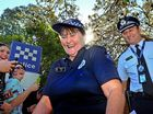 OH THE JOY: Sgt Dell Fisher walks out of Caloundra Police station for the last time after 42 years of service. Photo: John McCutcheon / Sunshine Coast Daily
