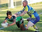 ALMOST THERE: Karl Leupold (right) from Gympie dives to prevent a try by Stags player Jiitaret Sukhanthapree.
