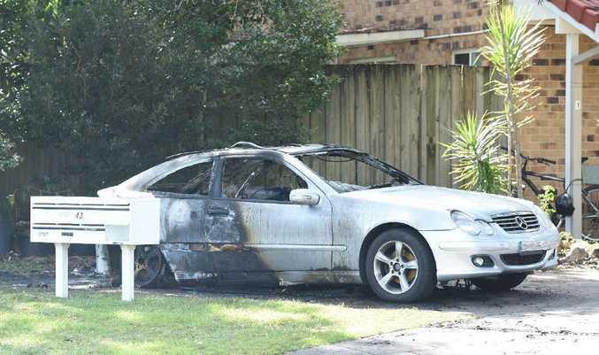 DAMAGE DONE: The Mercedes Benz destroyed in Belongil Crescent.