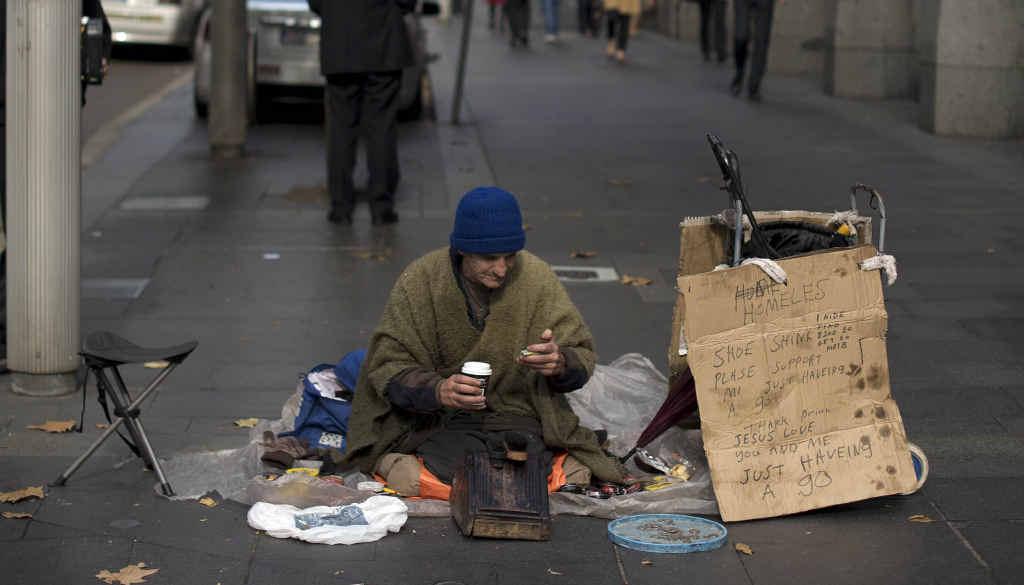 SLEEPING ROUGH: A homeless man sits on an Australian street.