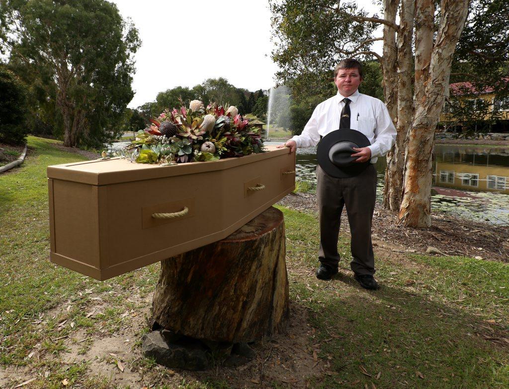 Ben Little from Dolphin Funerals with a cardboard coffin. Photo: Nolan Verheij-Full / Tweed Daily News