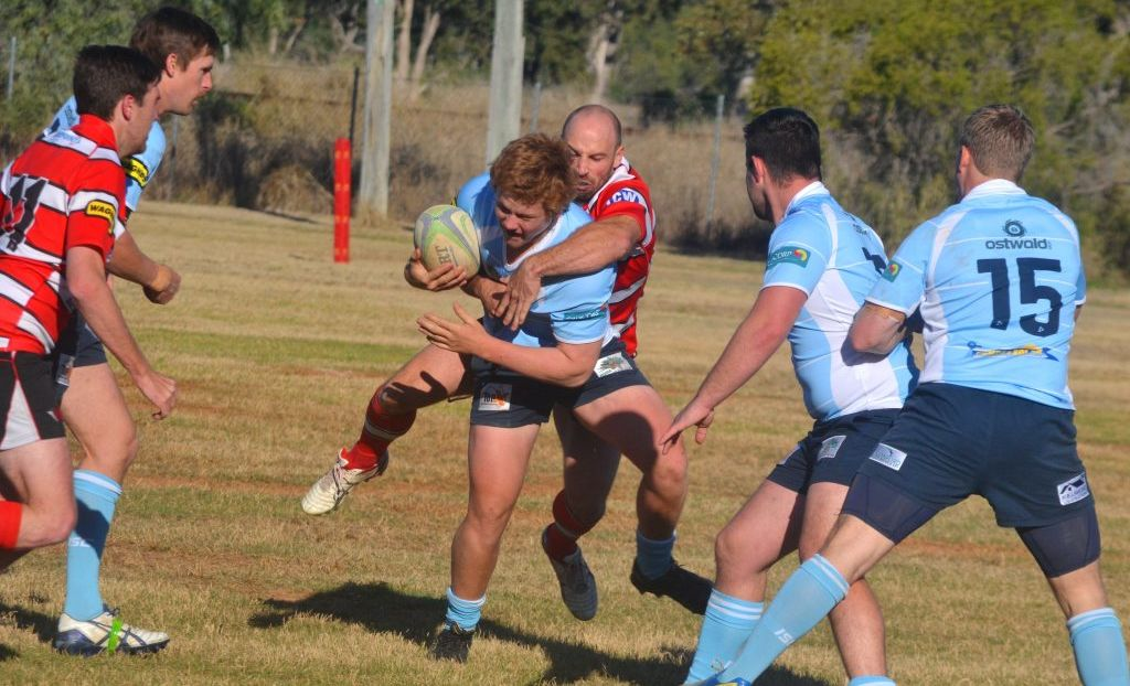 Toowoomba Rangers winger Grant Angell tries to wrap up Roma centre Lawson Dingle during his team's Risdon Cup win last Saturday at Gallas Fox Park.