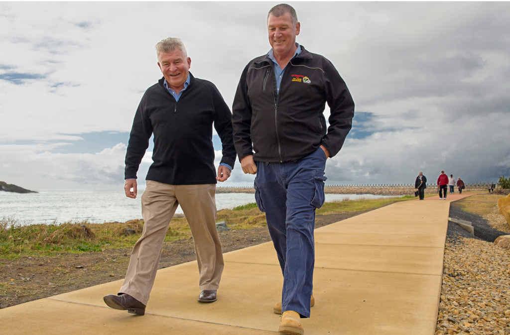STEP OUT: Rotary Club of Coffs Harbour Daybreak's Graeme Spink and Rotary Club of Coffs Harbour's Ray Smith take a stroll on the Wayne Glenn Rotary Walk.