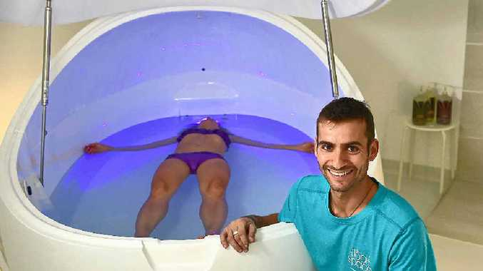 NOW OPEN: Owners of The Float Space, Felipe De Carvalho Galler (front) with Janina Hildebrand, who is floating in a mood-lit pod filled with buoyant saltwater.