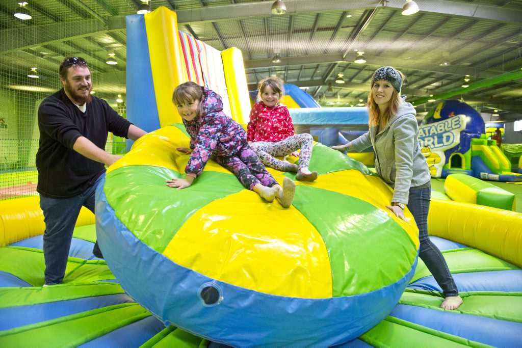 Having fun at Inflatable World (from left) Jeremy, Nevaeh, Leah and Mel Long.