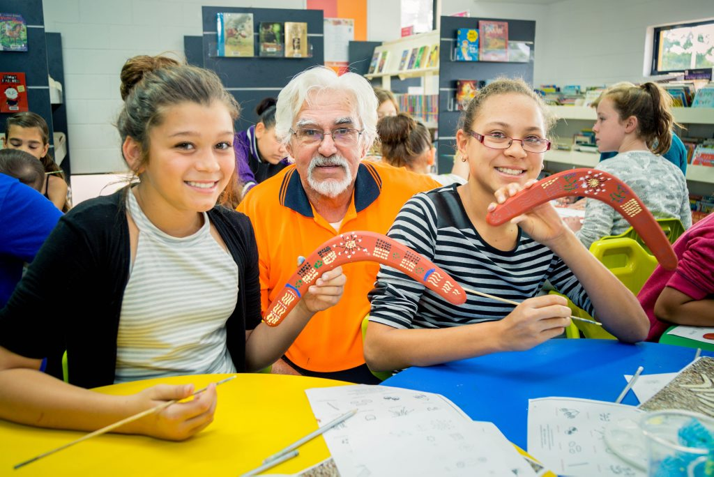 Alkira Sorbello, Lloyd Hornsby and Lily Ahmet at the Boomerang Art workshop in Moranbah.
