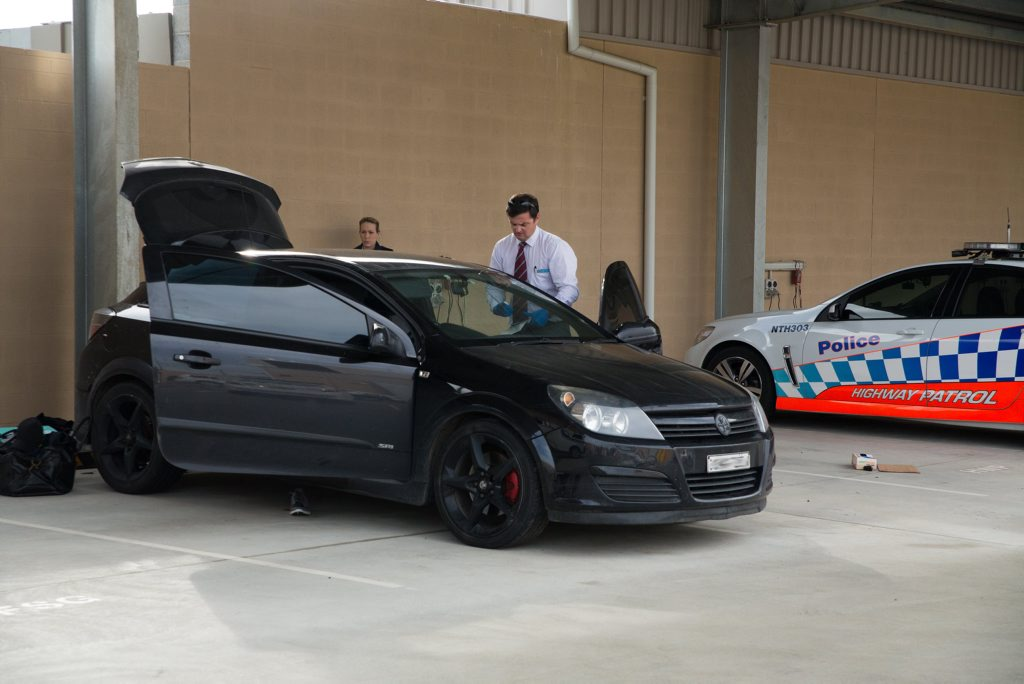 Police allege 90 grams of methamphetamine was concealed in the roof lining of this dark Holden Astra hatchback. Photo: Gemima Harvey/Coffs Coast Advocate