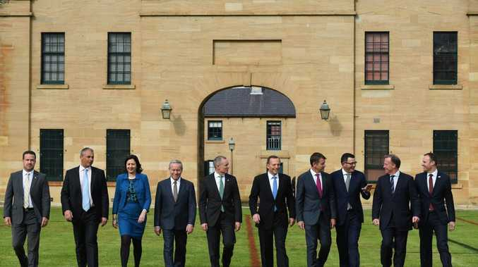 PHOTO SHOOT: State and territory leaders and a local government representative join Tony Abbott at Sydney's Victoria Barracks yesterday.