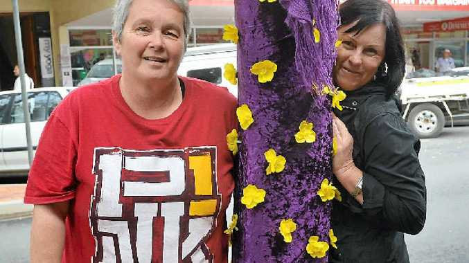 SPLENDID: Cathy Dubois and the Relay for Life tree.