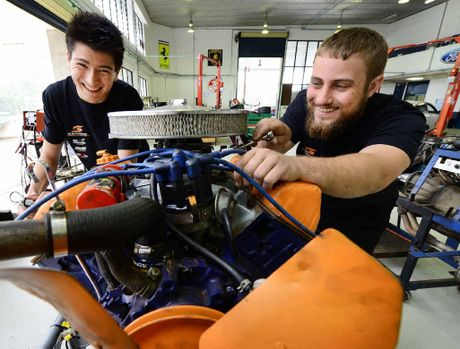 TOP GEAR: Mechanical students Jesse Milne (left) and Cheyne Willmann will be working with V8 Supercar pit crews during the upcoming V8 Supersprint event at Queensland Raceway.