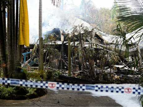 THE DAY AFTER: The smouldering ruins of a magnificent Queenslander that went up in flames in Byron Bay on Tuesday.