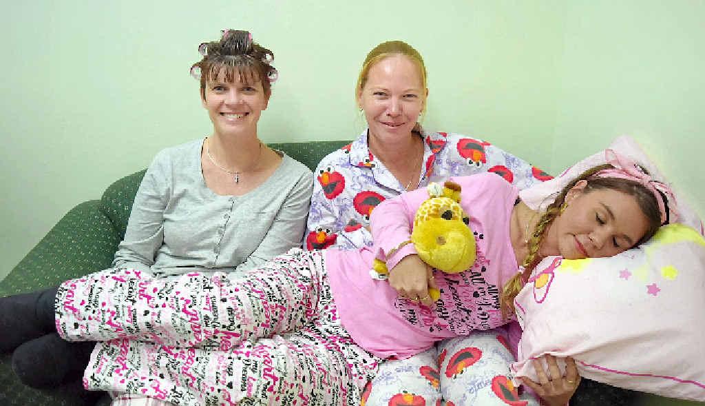 BEST WORK UNIFORM EVER: Whitsunday Neighbourhood Centre's Tamara Noble, Kerri Brown and Peita Rollings.