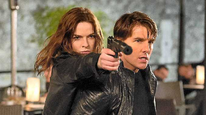 Rebecca Ferguson and Tom Cruise in a scene from the movie Mission: Impossible – Rogue Nation.