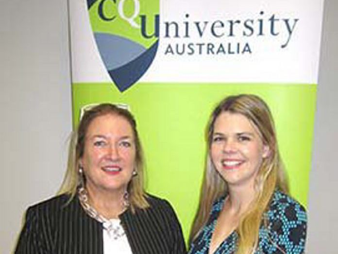 STUDY SUCCESS: CQU oral health graduate Jessica Younger (right) is congratulated by One Dental rep Jill Tayler. Contributed