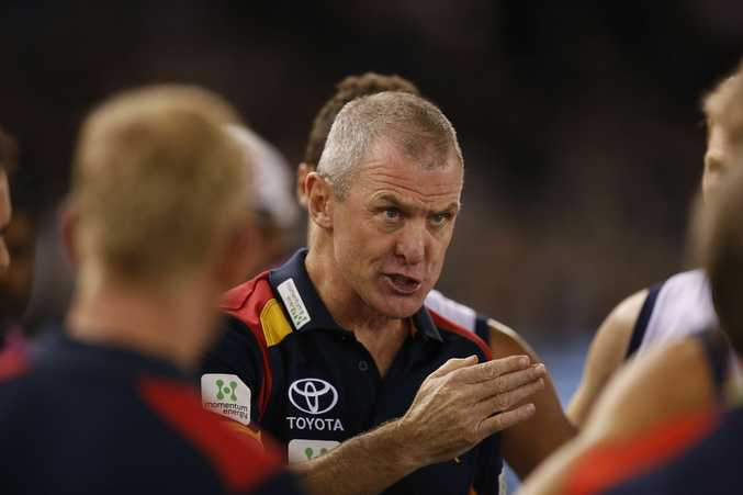 Adelaide coach Phil Walsh talks to his troops during a match earlier this season.