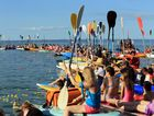 Paddles were raised and the water was littered with flowers in honor of the Humpback Whales. Photo: Brendan Bufi / Fraser Coast Chronicle