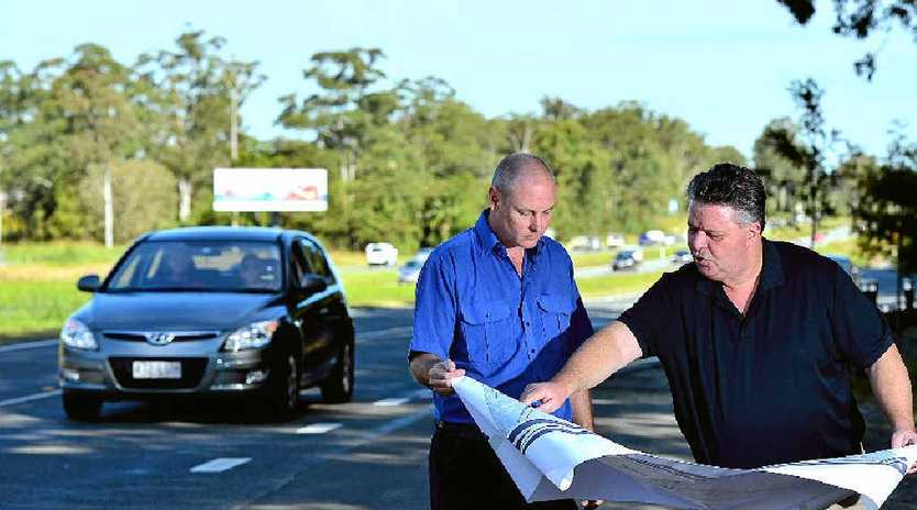 NOT HAPPY: Aussie World Garage owner Steve Amos and Mike Doroshenko, founder of Save Exit190 discuss the proposed changes on site at Frizzo Rd.