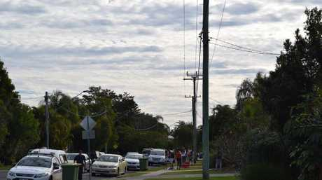 Neighbours gather around after an alleged drive-by shooting at Hilton Terrace at Noosaville.