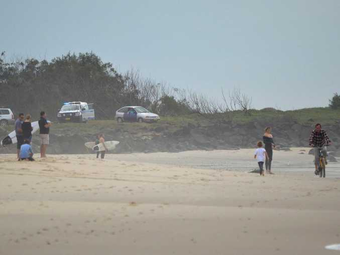 An image posted on the Ballina Info Facebook page showing police warning surfers at Black Head, Ballina, that a shark had been spotted in the area on Sunday morning.