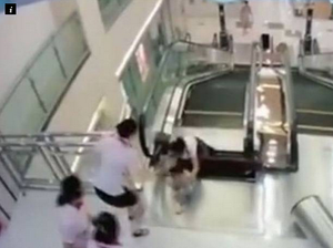 Mother saves son before being swallowed by escalator