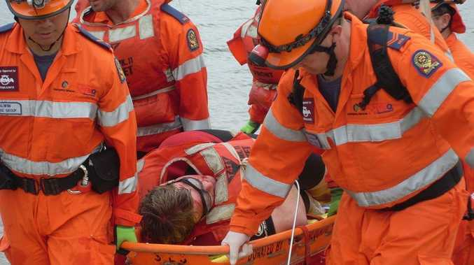 Disaster Battles: A team from the previous year's SES competition work to rescue a 'victim.'