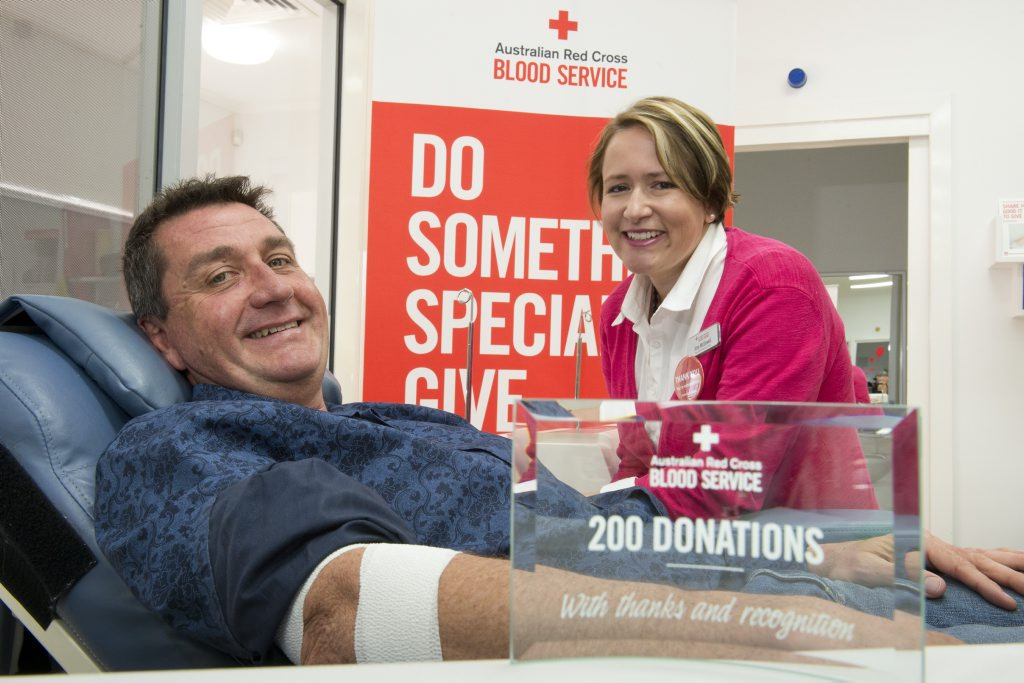 Brad Jones is thanked by Amy McDowell of Australian Red Cross Blood Service after having donated 200 times, Tuesday, July 28, 2015. Photo Kevin Farmer / The Chronicle