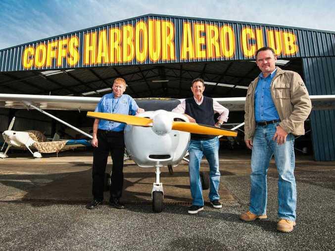 BLEAK OUTLOOK: Coffs Harbour Aero Club directors Norman Turner, Tony Donelan and Stewart Mackie with the club's Jabiru aircraft.