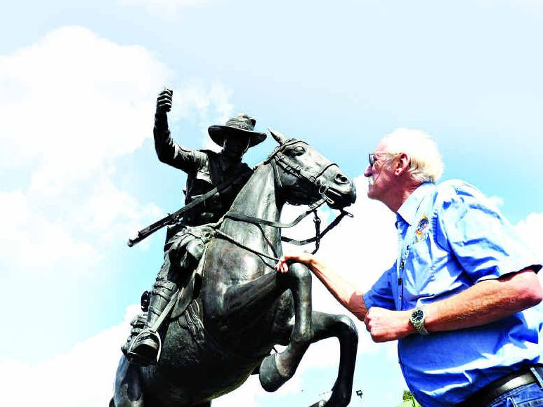 Hervey Bay RSL Sub-Branch president John Kelsey looks at the 5th Light Horse statue after it was vandalised.