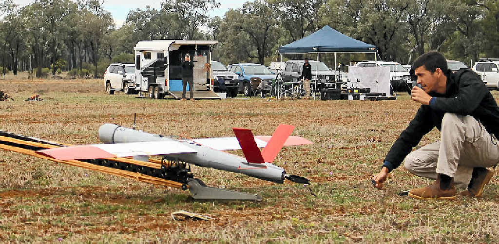READY TO FLY: Ninox representative Daniel Vogelnest about to launch the drone at Warrowa, west of Moonie.