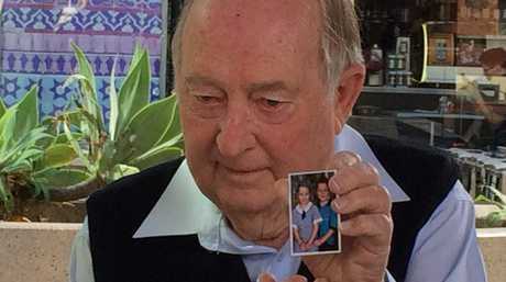 William Sweet with a picture of his granddaughter Lilli.