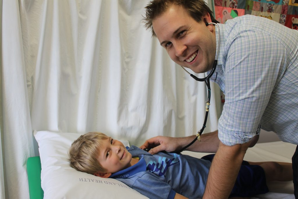 HAPPY PATIENT: Dr Matt Wakeley estimates the new paediatric outreach clinic at Monto Hospital will run four times a year. Tyler Keitley is one of the first patients.